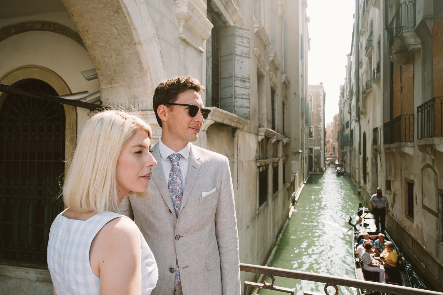 bride and groom taking a walk through venice streets