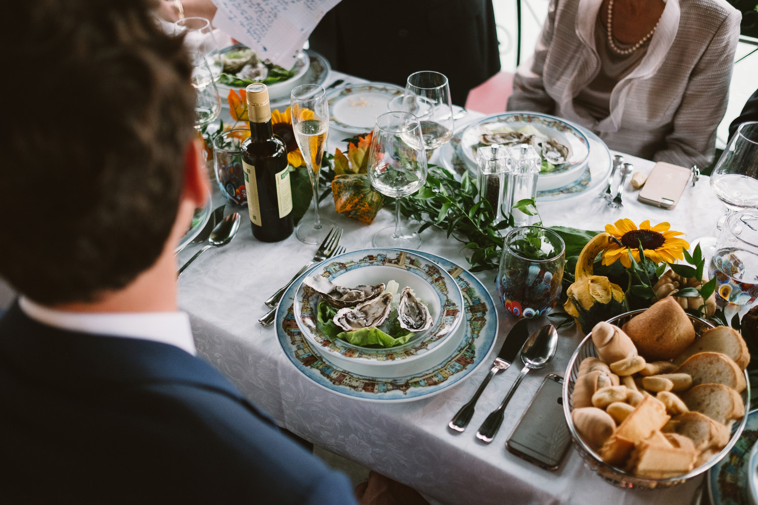 bride and groom and guests burano wedding meal in venice by davi