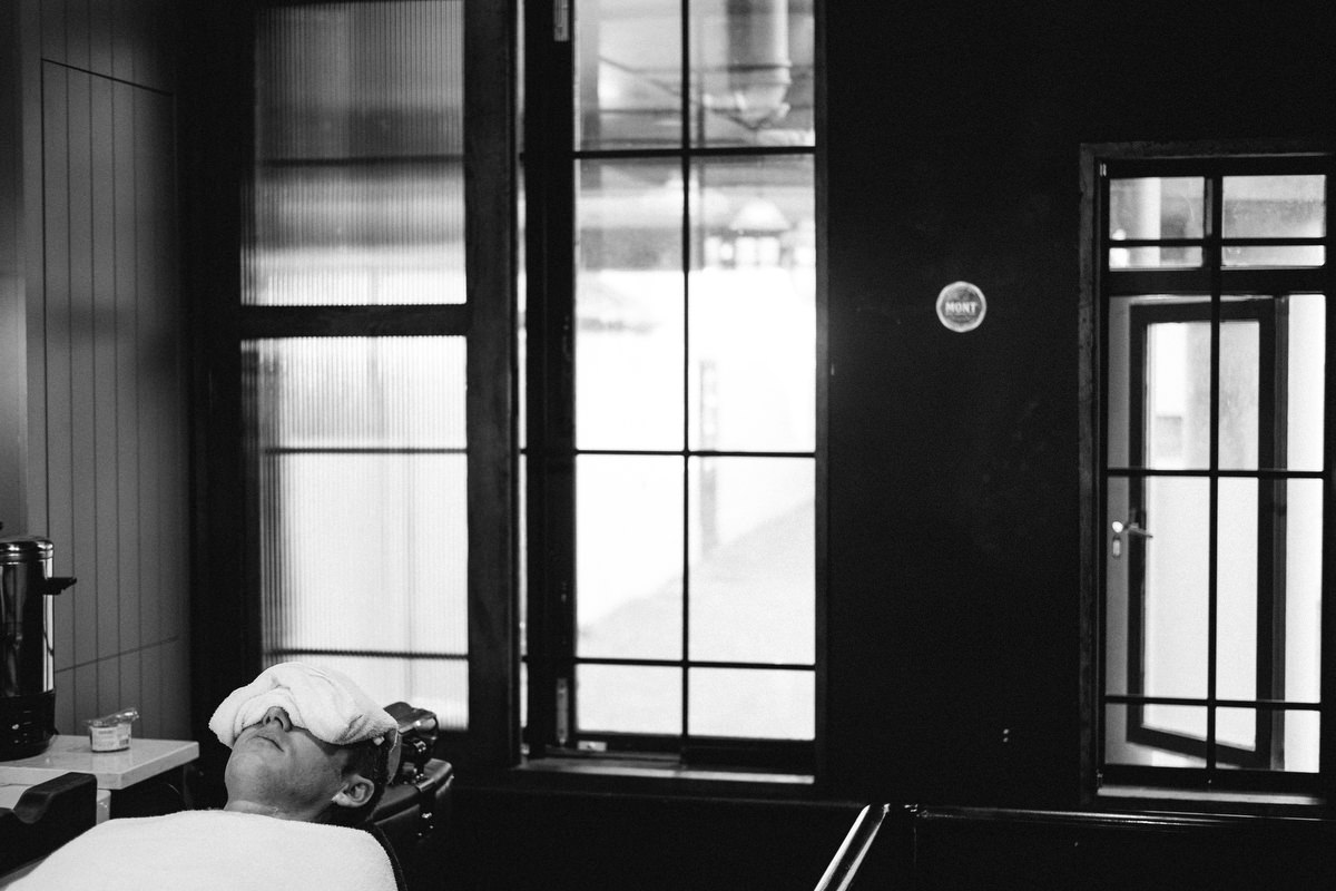 relaxed groom at barbers in dublin