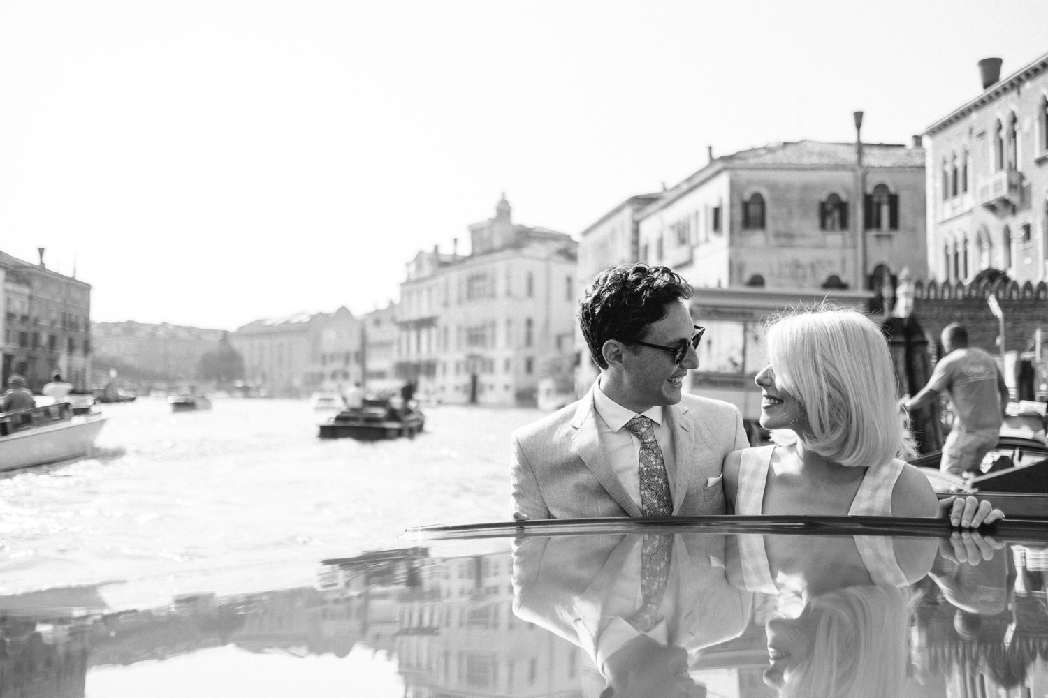 bride and groom on water taxi in venice taken with fujifilm xt2