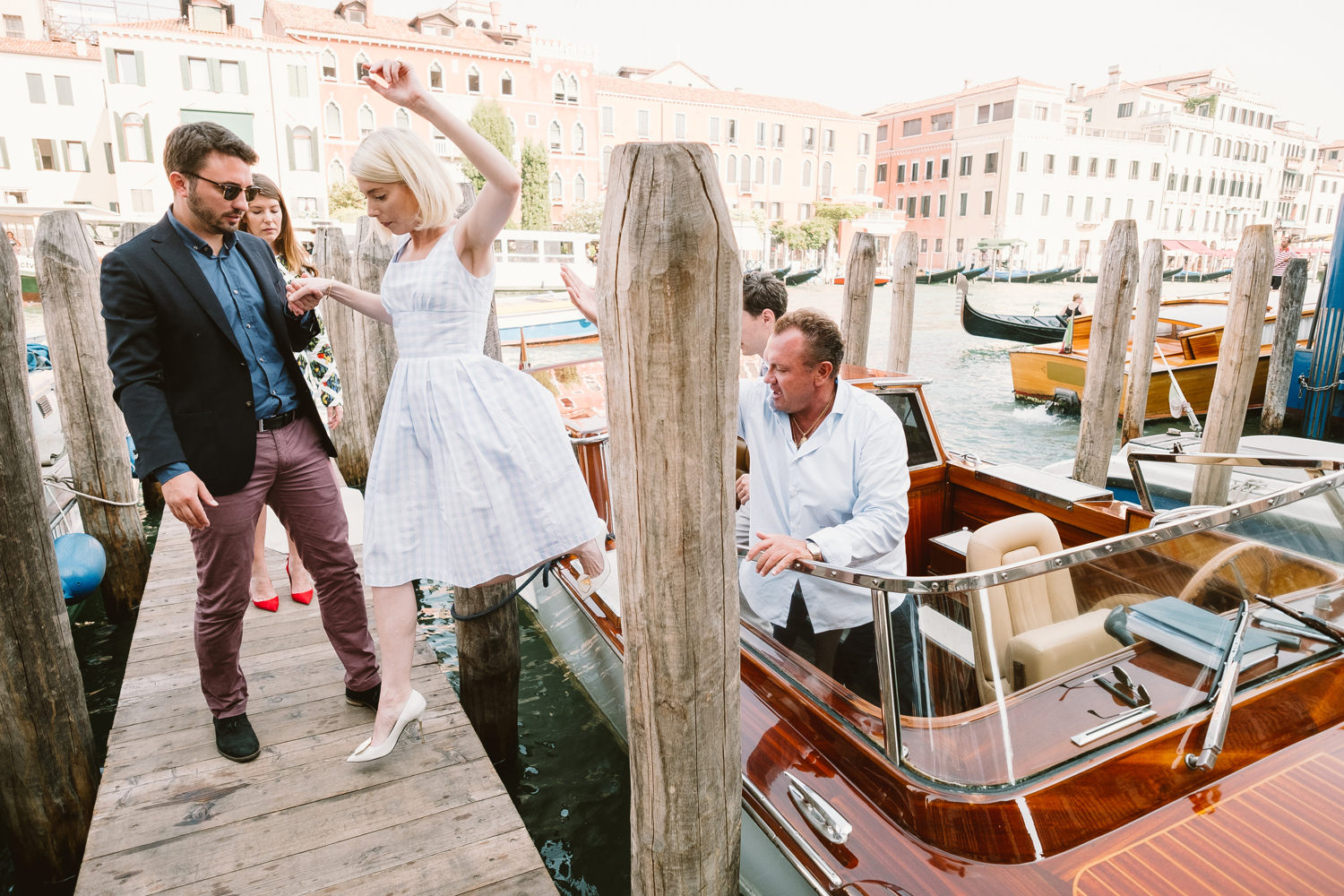bride getting of boat