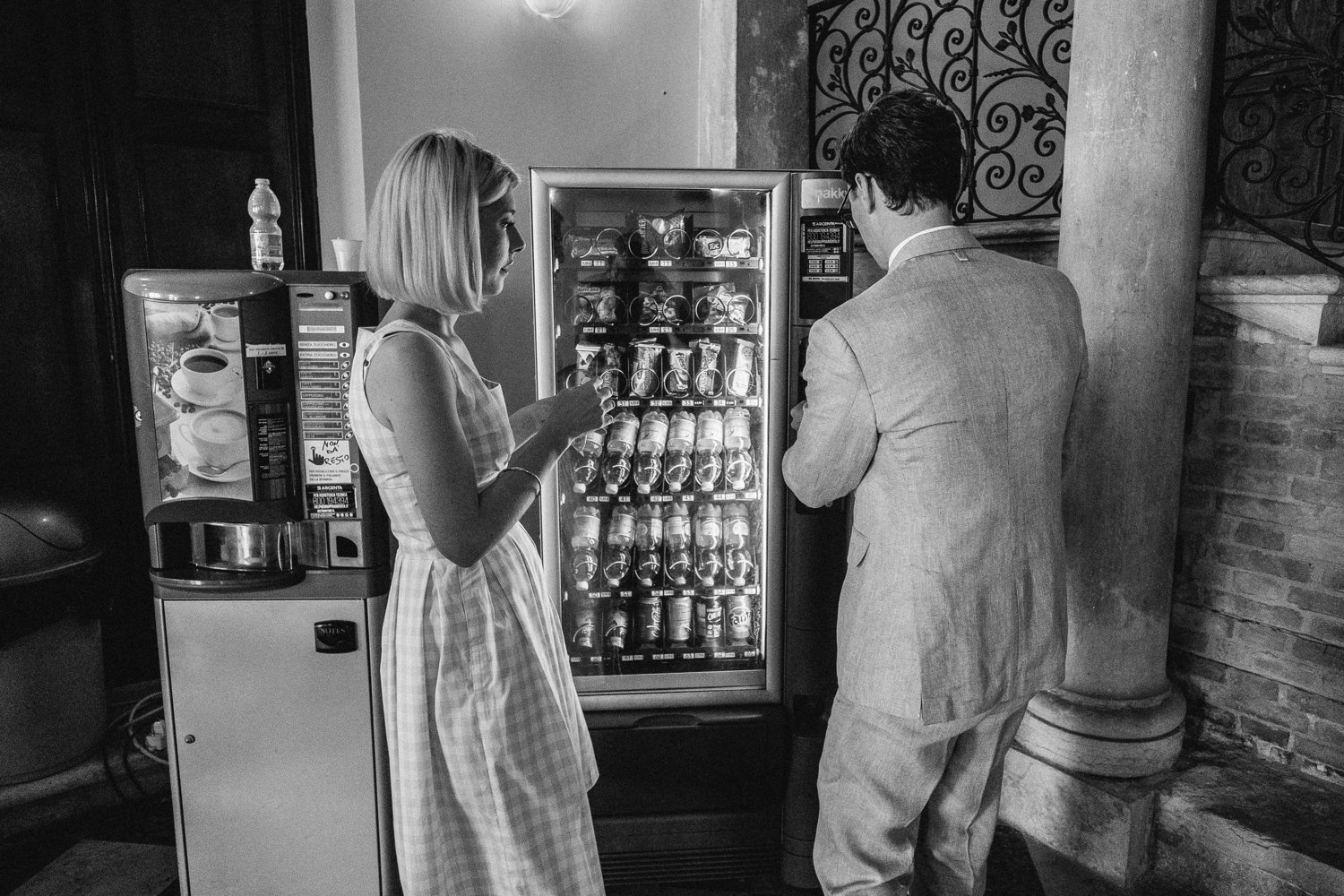 bride and groom getting a snack at vending machine xpro2