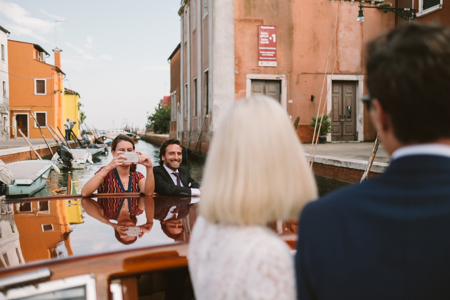 bride and groom on boat from burano to venice by fujix photograp