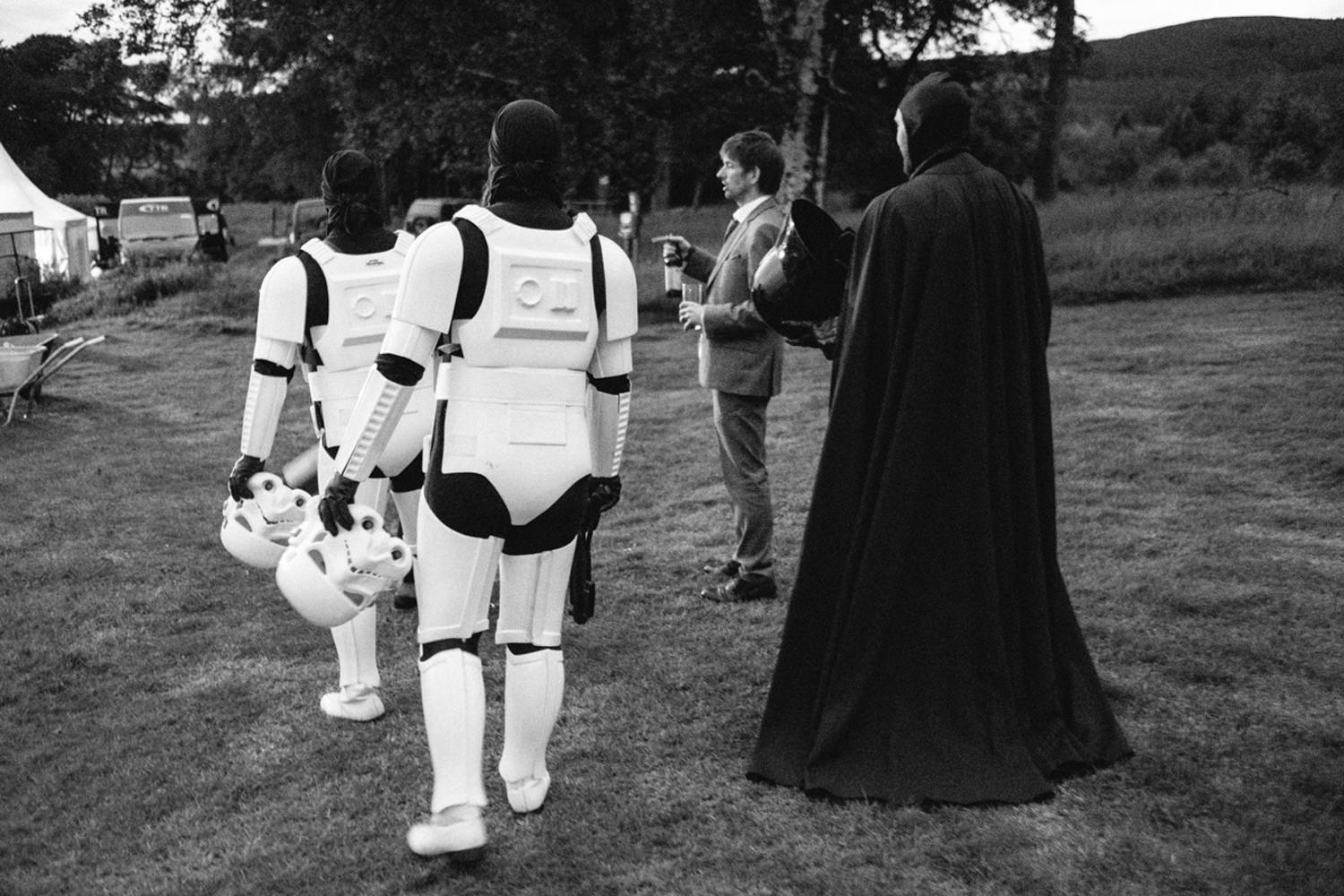light sabers with star wars characters at a wedding