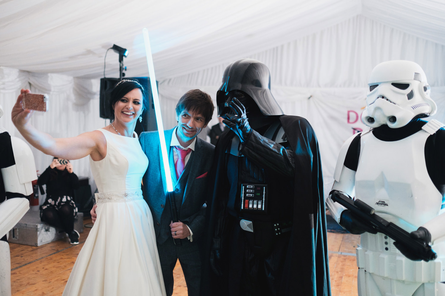 bride and groom with darth vader and storm troopers
