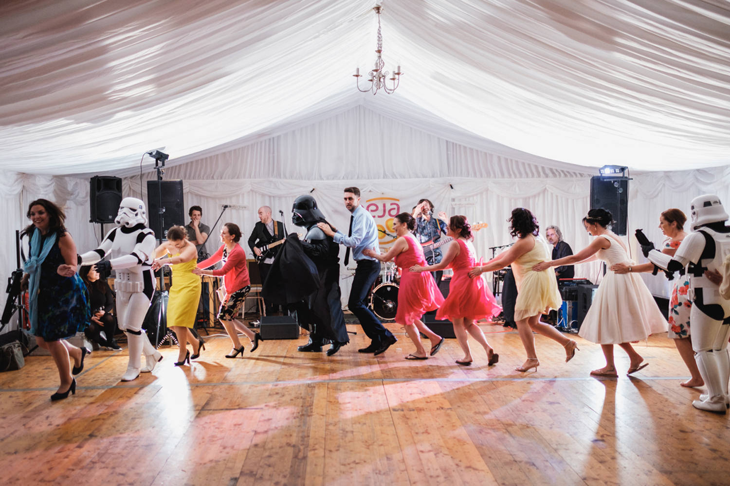 wedding guests dancing with storm trooper and darth vader from s