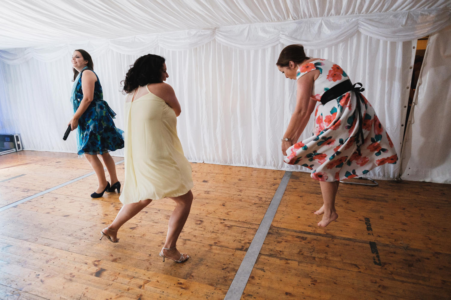 wedding guests dancing with invisible light sabers